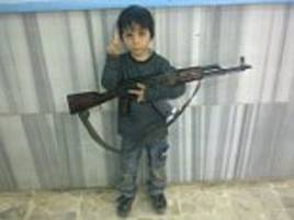 Toddler with AK47s, preachers of hate and even 'ISIS fighter who captured Jordanian pilot who was burned alive': Revealed, the terrifying Facebook network linked to Jihadi John's brother
